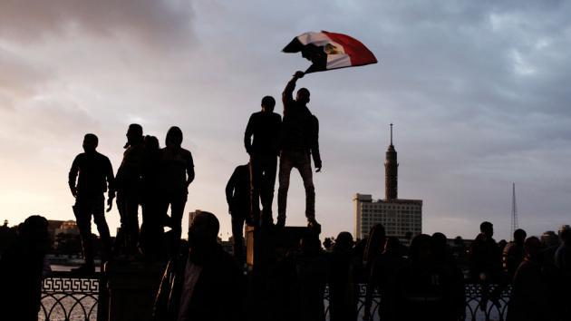Men waving the Egyptian flag in Cairo (photo: Ed Giles/Getty Images)