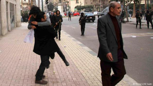The injured Shaima Al-Sabbagh being carried away from the scene of her shooting (photo: Reuters/Al Saabi)