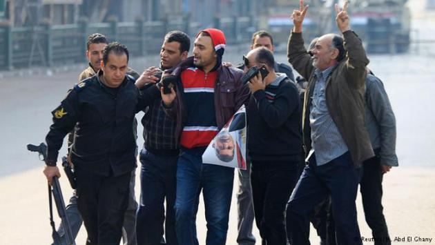 Muslim brotherhood supporters being led away (photo: Reuters/M. Abd El Ghany)