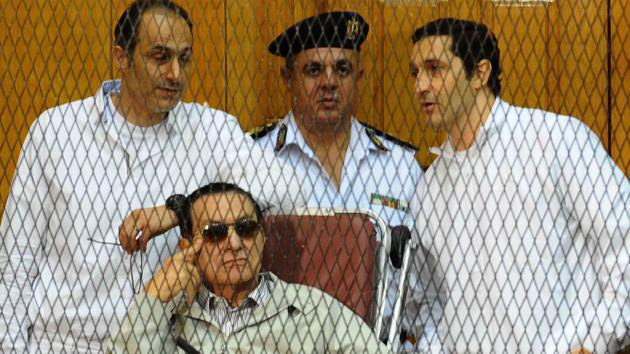 Hosni Mubarak and his sons in court (photo: Ahmed El-Malky/AFP/Getty Images)