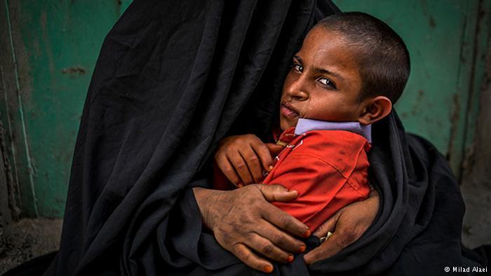 Beggar in chador (photo: Milad Alaei)