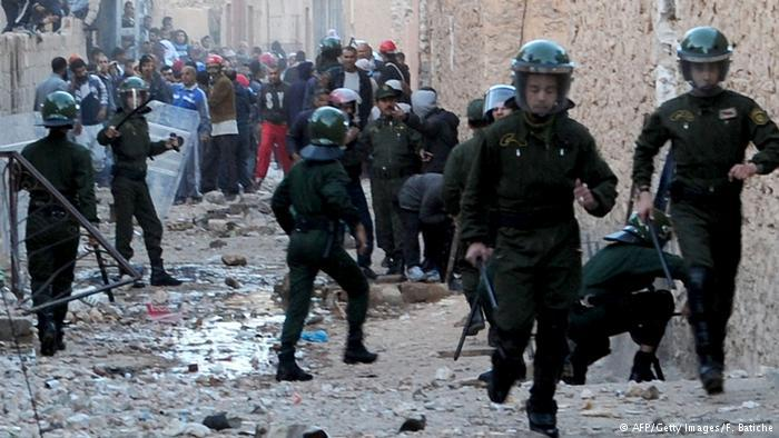 Police during a riot in Algeria (photo: AFP/Getty Images/F. Batiche)