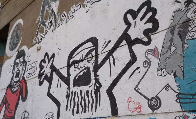 The Ikhwan portrayed as a frightening figure, graffiti on Mohamed Mahmoud St, Cairo (photo: Arian Fariborz)