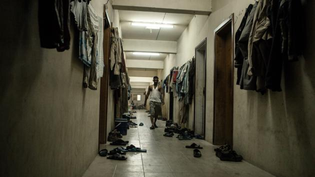 Hallway of typical living quarters for foreign workers (photo: Sam Tarling)
