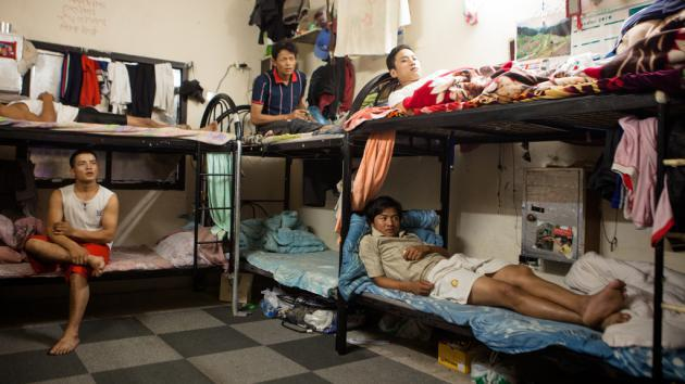 Nepalese workers in a dormitory for foreign workers, Qatar (photo: Sam Tarling)