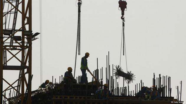 Foreign workers on a construction site in Doha, Qatar (photo: Getty Images)