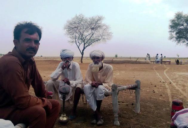Men sitting on a charpoy, Cholistan desert, Pakistan (photo: Usman Mahar)