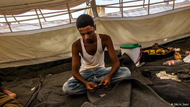 Searching for a better future: Aiham Ehab Makyam, 21, sits in his tent in the UNCHR-hosted refugee camp near Obock in Djibouti. He left his family in Aden after his father told him that he still has a chance of a better future. In Yemen, says Aiham, that is impossible.