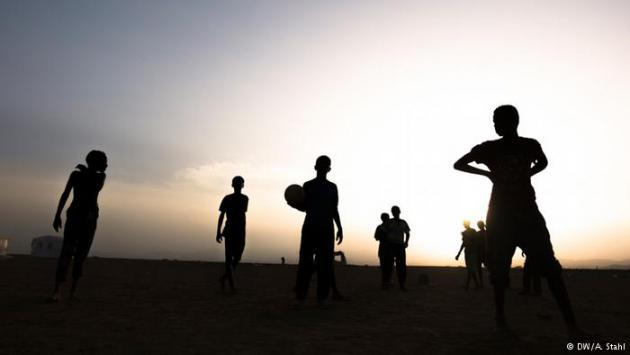 Refugee children from Yemen play football in Markazi refugee camp as the sun goes down. According to UNICEF, almost 8 million children in Yemen are suffering from the effects of the conflict and are in need of humanitarian assistance. In Yemen, there is an acute lack of food and drinking water.
