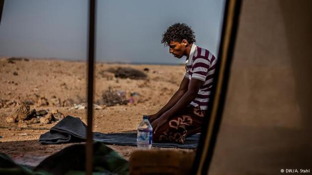 A refugee from Yemen prays outside his tent in Markazi refugee camp near Obock, Djibouti. As of 2 June, the UN estimated that around 16 million people in Yemen were in need of humanitarian assistance.