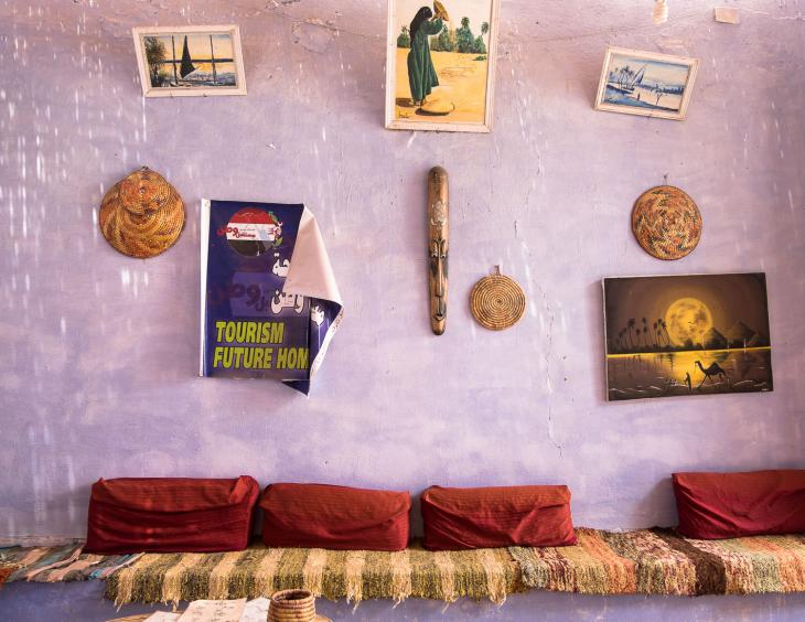Tourism-related posters in a cafe in the Nubian village of Western Suheil (photo: Maya Hautefeuille)