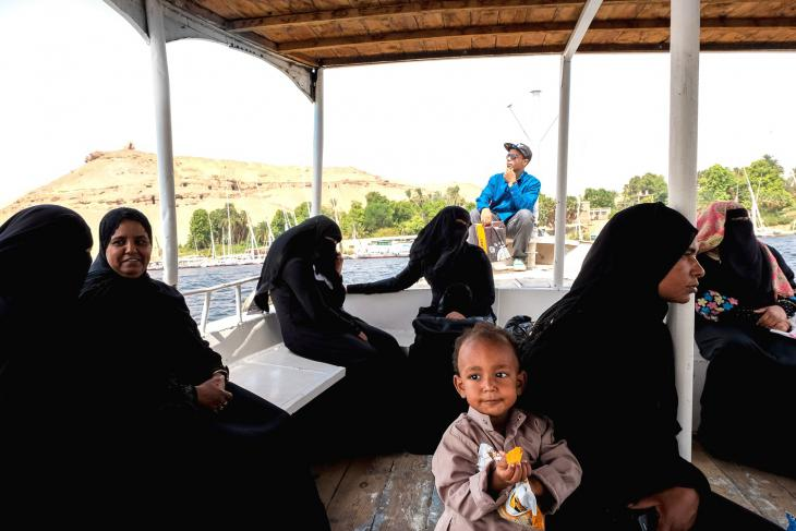 Women travelling to West Aswan on a river taxi (photo: Maya Hautefeuille)