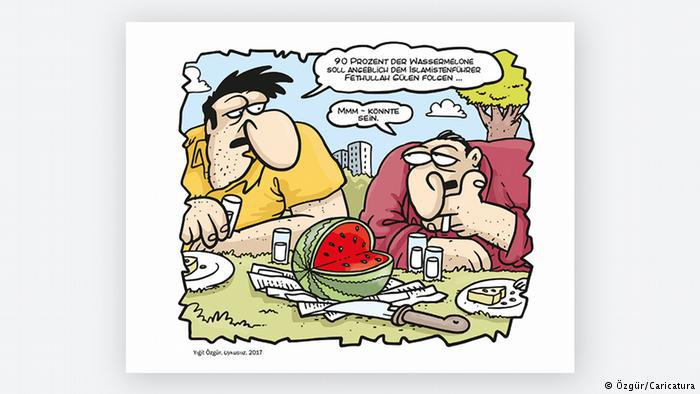 Cartoon by Yigit Ozgur, two men and a watermelon (photo: Ozgur/Caricatura)
