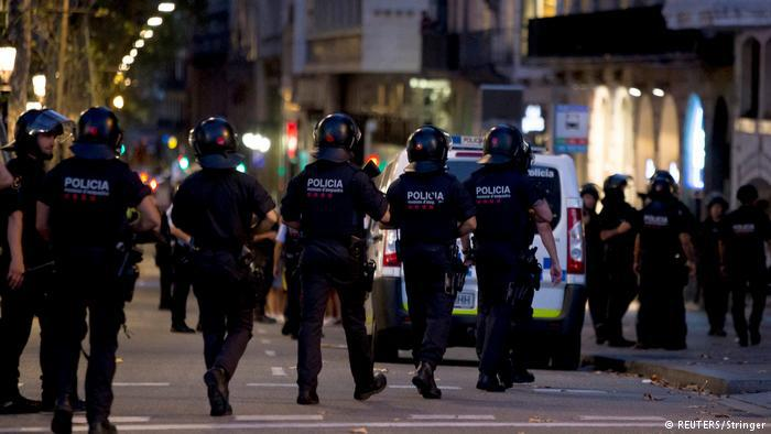 Spanish police officers walking down the road