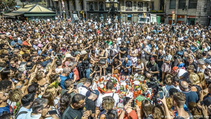 A crowd of people stand in Las Ramblas