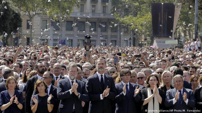 Crowds hold a minute of silence on Las Ramblas