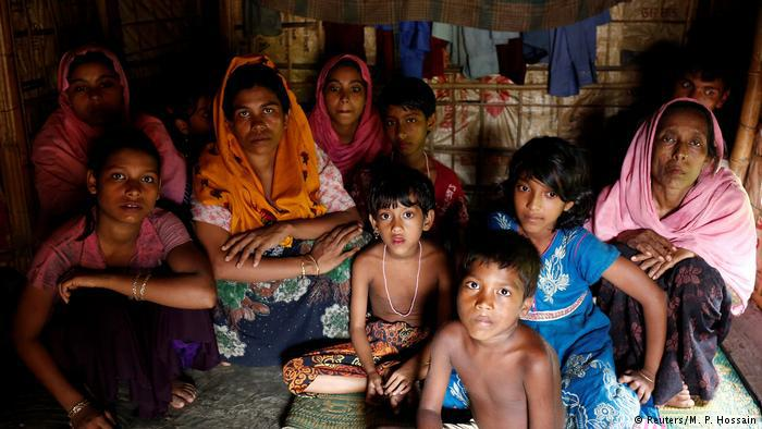 Rohingya refugees take shelter at the Kutuupalang makeshift refugee camp