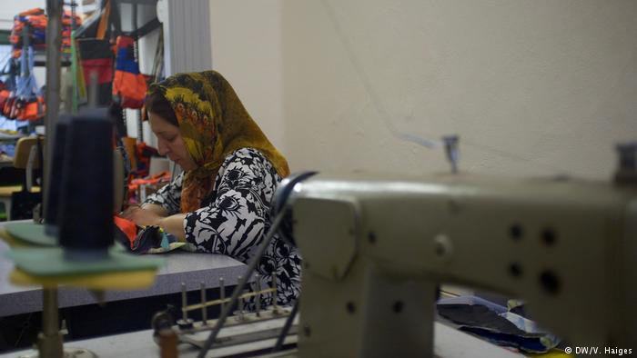A woman works away at a sewing-machine