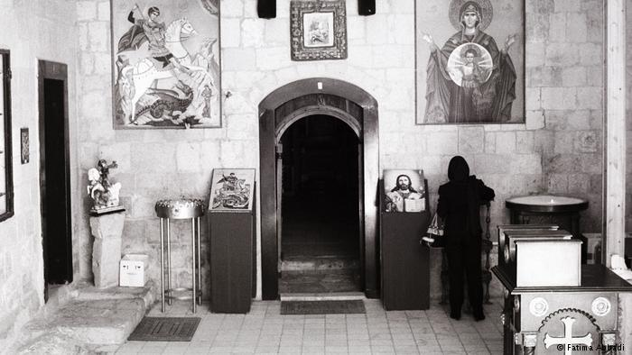 A woman in St. George's Church (photo: Fatima Abbadi)
