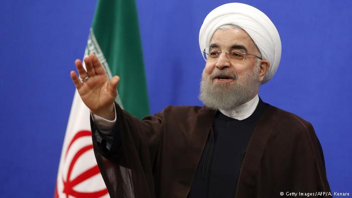Iranian President Rouhani gestures during a televised speech