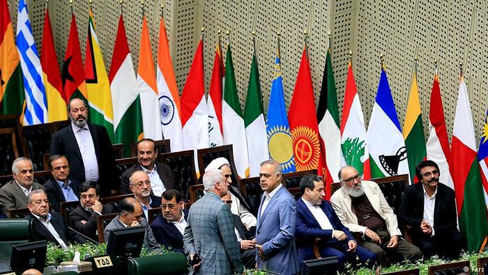 Flags line the parliamentary chamber for the inauguration of the Iranian president