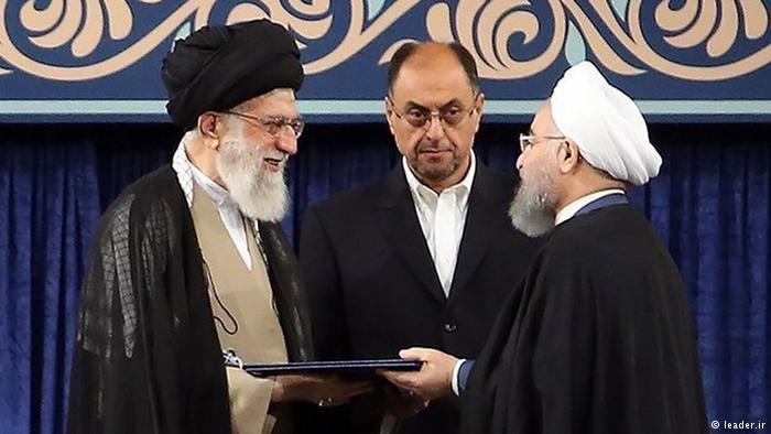 Iran's supreme leader, Ayatollah Ali Khamenei (left) formally endorses President Rouhani (right) for a second term in office