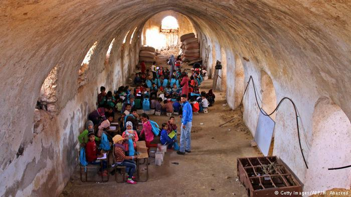 Children study in a barn in Syria (photo: Getty Images/AFP/M. Abazeed)