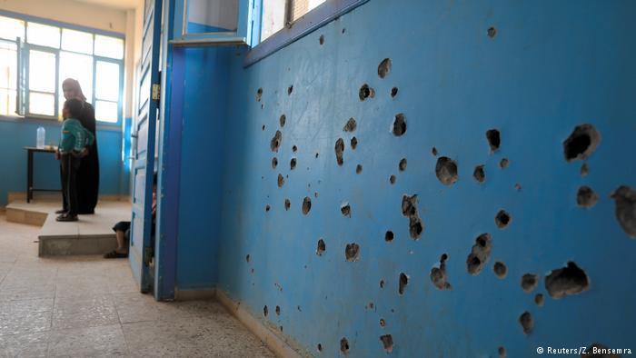 Bullet holes in a wall of a school in Syria (photo: Reuters/Z. Bensemra)