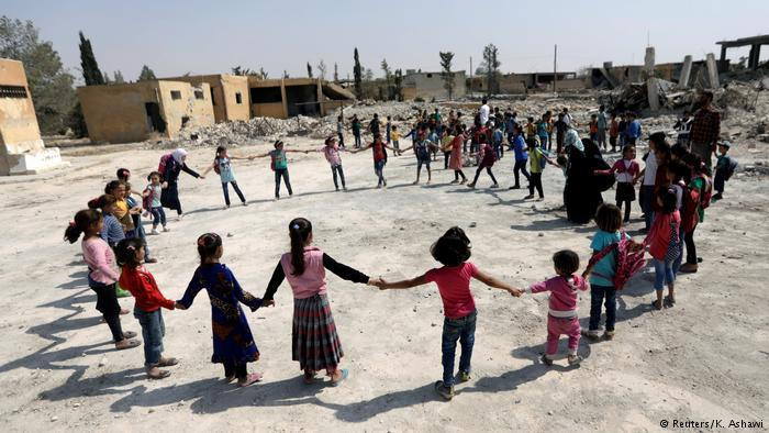 Children playing at a school in al-Saflaniyeh (photo: Reuters/K. Ashawi)