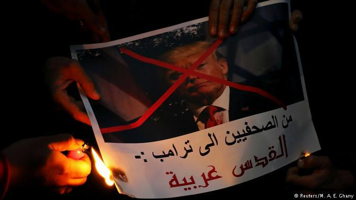 Protesters in Egypt burn a picture of U.S. President Donald Trump with his face crossed out during a protest in front of the Syndicate of Journalists in Cairo. The picture reads, Journalists are telling you Trump, Jerusalem in Arab. Hundreds of protesters also gathered in Al-Azhar mosque and outside in its courtyard (photo: Reuters/M. A. E. Ghany)