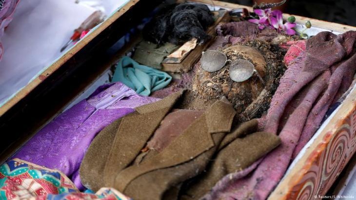 Mummified remains of a man revealed during the opening of a coffin by relatives at Loko'mata, an ancient Torajan burial site, during the Ma'nene death ritual near Rantepao (North Toraja) on Sulawesi (photo: Darren Whiteside/Reuters)