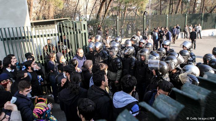 Students face police at Tehran University, 30 December 2017 (photo: Getty Images/AFP)