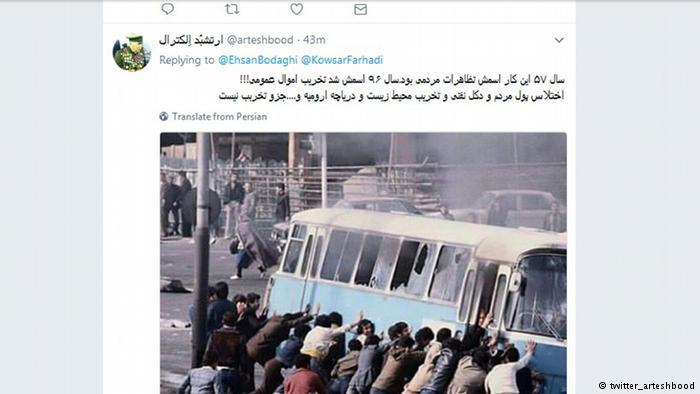 Protesters push over a bus (source: twitter_arteshbood)