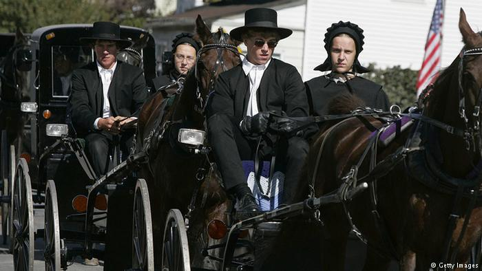 Amish people driving a buggy (photo: Getty Images)