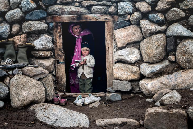 A Wakhi shepherdess with her child in their rock shelter (photo: Camille Del Bos)