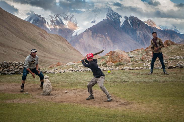 Young Wakhi men playing cricket (photo: Camille Del Bos)