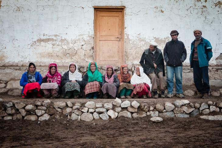 "Wakhi people sitting in front of a ""jamaat khana"" (photo: Camille Del Bos)"