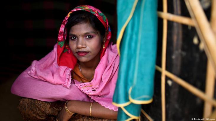 A Rohingya refugee girl named Sakila Begum, aged 15, poses for a photograph as she wears thanaka paste at Jamtoli camp in Cox's Bazaar, Bangladesh, 1 April 2018 (photo: Reuters/Clodagh Kilcoyne)