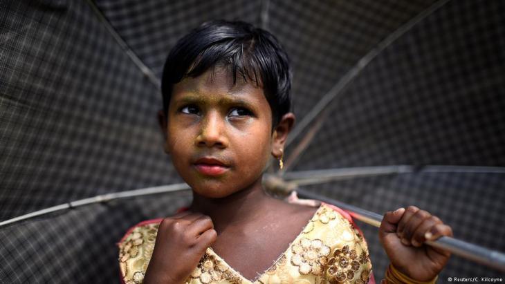 A Rohingya refugee girl named Zinu Ara, aged 4, poses for a photograph as she wears thanaka paste at Balukhali camp in Cox's Bazaar, Bangladesh, 31 March 2018 (photo: Reuters/Clodagh Kilcoyne)