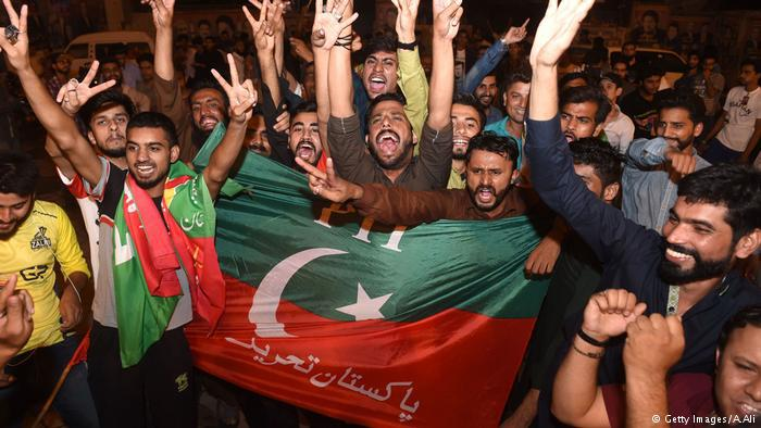 Imran Khan supporters celebrate PTI's election victory (photo: Getty Images/A. Ali)