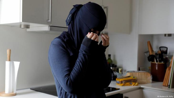 Ayah, 37, a wearer of the niqab, wipes tears from her eyes on the first day of the implementation of the Danish face veil ban on 1 August 2018 (photo: Reuters/Andrew Kelly)
