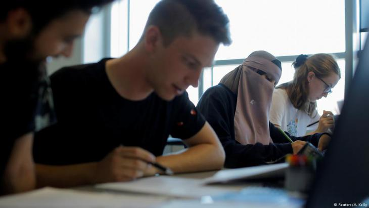 Meryem (second from right), 20, sits with classmates Ahmad, Kasper and Caroline (left to right) during a supplemental summer class on math B-A level in Aarhus, Denmark, 27 July 2018 (photo: Reuters/Andrew Kelly)