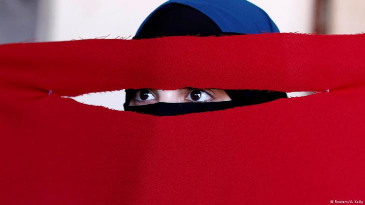 Alaa, 21, a student of health and nutrition, born in Copenhagen and wearer of the niqab, tests a face veil she created with members of the group Kvinder I Dialog (Women In Dialogue) during a workshop in preparation for the August 1 protest against the face veil ban in Copenhagen, Denmark (photo: Reuters/Andrew Kelly)