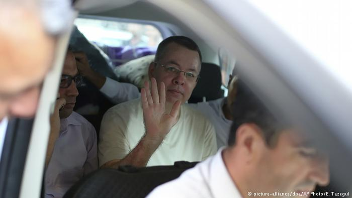 Brunson waves from his car as he arrives at his house in Izmir