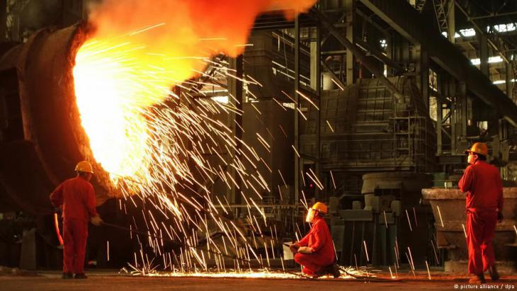 Chinese steel workers at a plant in Dalian city, Liaoning province, China