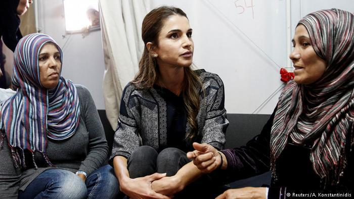 Queen Rania of Jordan, wearing no veil as she speaks to women wearing hijab at a refugee facility in Greecde (photo: Reuters/A. Kontantinidis)
