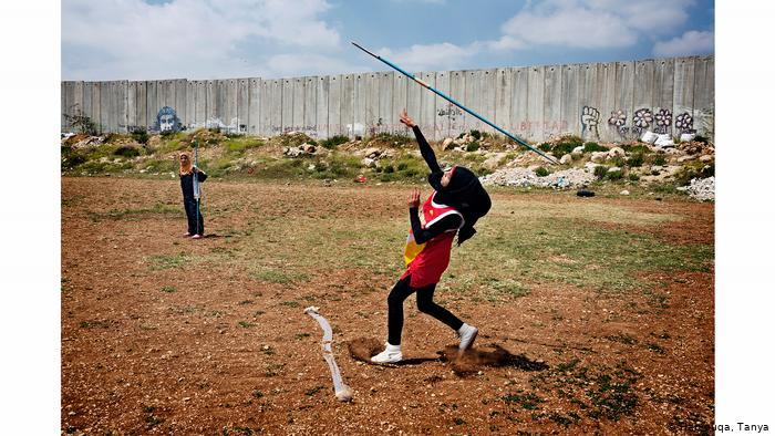 Young Muslim girls throwing javelins (photo: Tanya Habjouqa)
