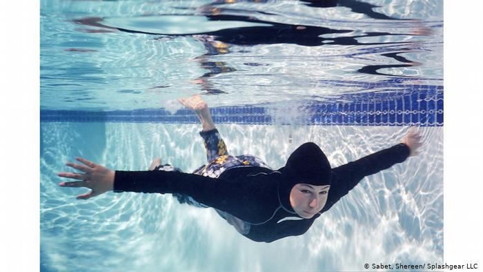 A Muslim woman swims in a hijab full body swimsuit (photo: Shereen Sabet/Splashgear LLC)