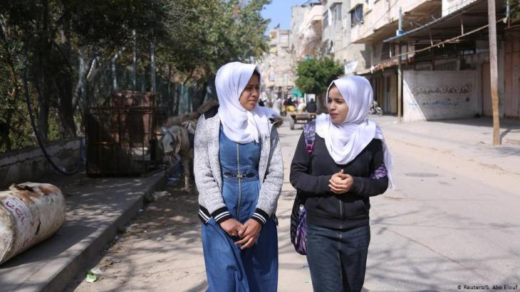 Wessal Abu Amra (right) and a schoolfriend walk in Gaza City (photo: Reuters/Samar Abo Elouf)