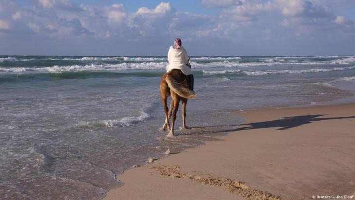 Suad Dawood rides a horse on a beach in Gaza City (photo: Reuters/Samar Abo Elouf)